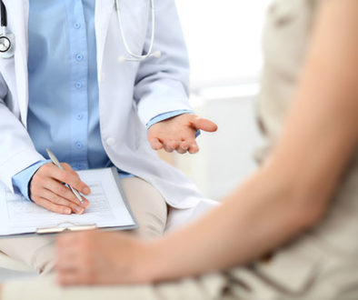 Doctor speaking with female patient about ectopic pregnancy